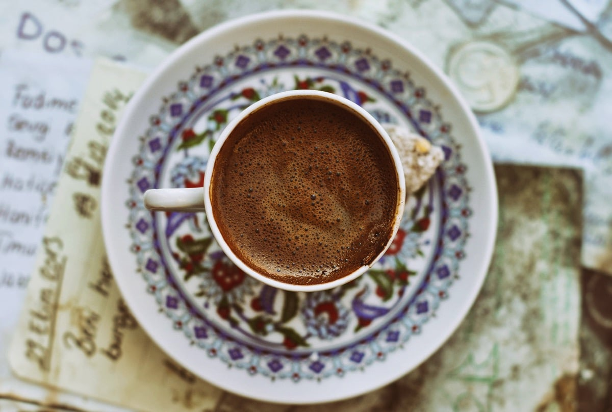 How to drink Turkish coffee? Served in a demitasse with plenty of foam on top.