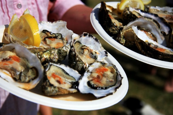 Two trays of dressed oysters at Rock Oyster Festival, an event bringing together the best of Cornish food and produce, music and entertainment. (Photo Credit: Rock Oyster Festival)