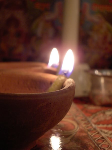 Every year, people burn little lamps (diyas) to light Lakshmi's path into their homes.(Photo Credit: divali )ct 2006 048 by Flickr user viknanda)