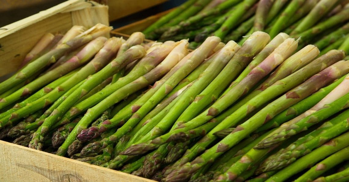 Green asparagus in a wooden crate