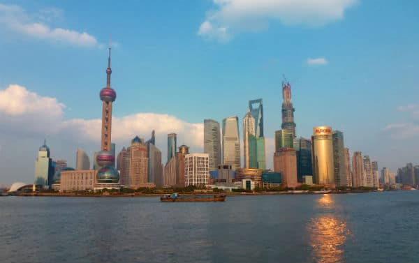 Watching the sun come down over the Pudong skyline is magical ! Photo credit: Christine Cognieux