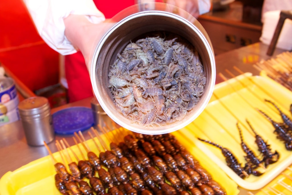 Are you ready for some freshly grilled scorpion on a skewer? (photo credit: Yann Cognieux)