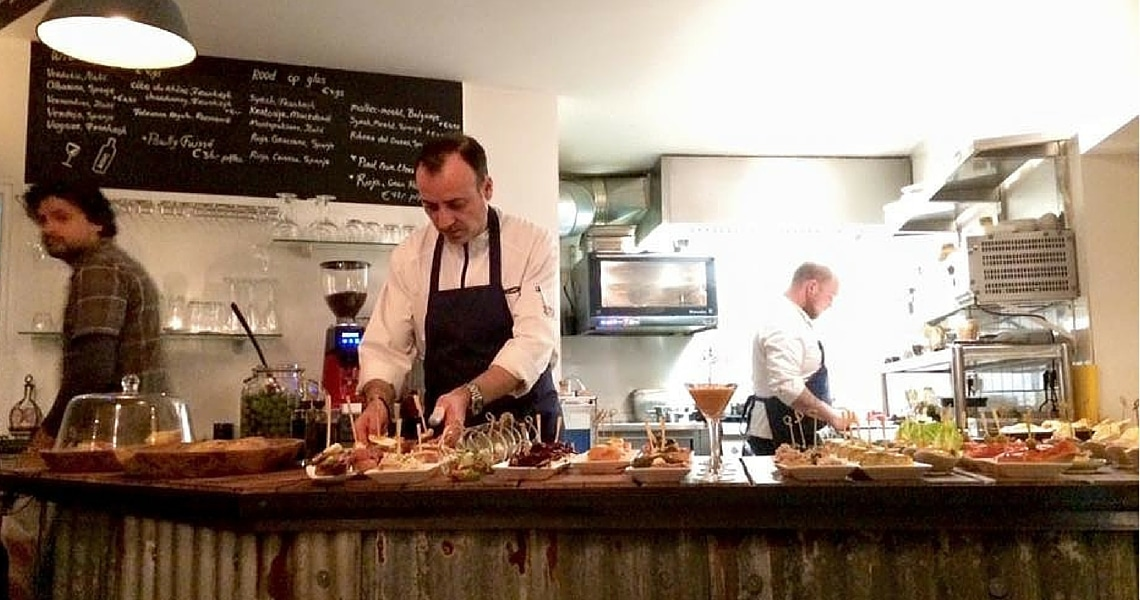 It's so much fun to watch the two chefs prepare the Pintxos in the open kitchen. (Photo credit: Christine Cognieux)