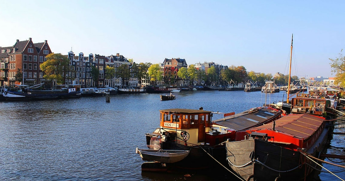 Taking a boat ride on a Dutch canal is a fun way to explore the city. (photo credit: Amsterdam & Beyond)