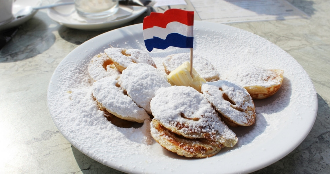 Ali's personal favorite Dutch dish consists of Poffertjes, butter, and lots and lots of powdered sugar. (photo credit: Amsterdam & Beyond)