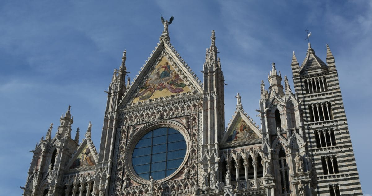 The black and white stone contributes to the Gothic style of the Siena Duomo. (Photo credit: Yann Cognieux)