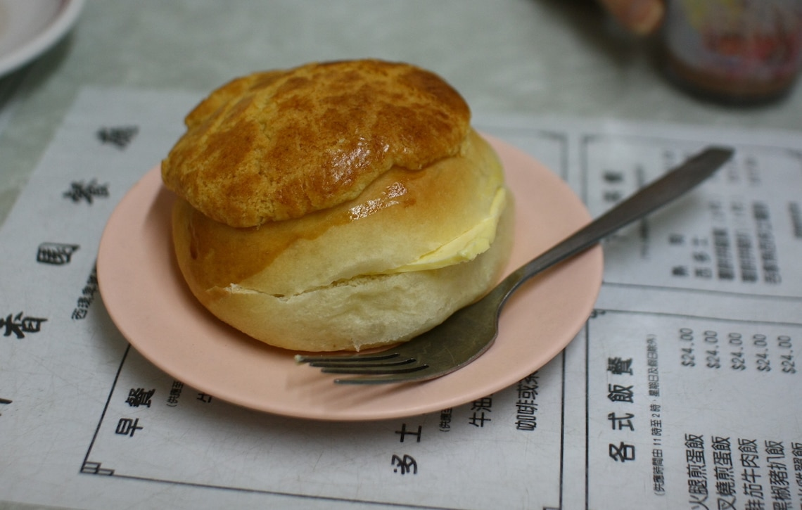 Pineapple bun served with a thick slab of butter.