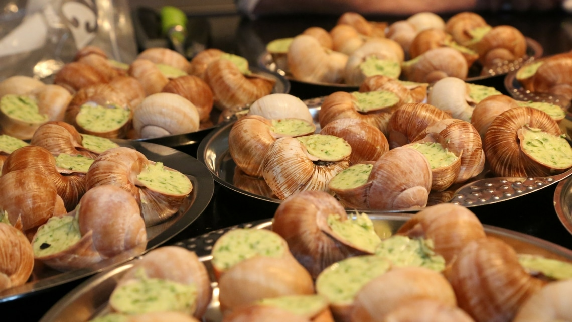 Escargots à la Bourguignonne: snails in garlic–herb butter. (Photo Credit: Yann Cognieux)