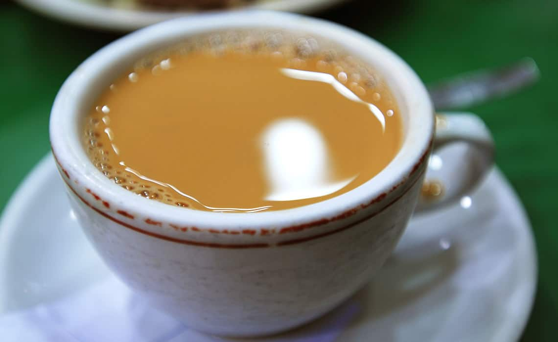 A hot milk tea or yuanyang served in a HK diner style coffee mug.