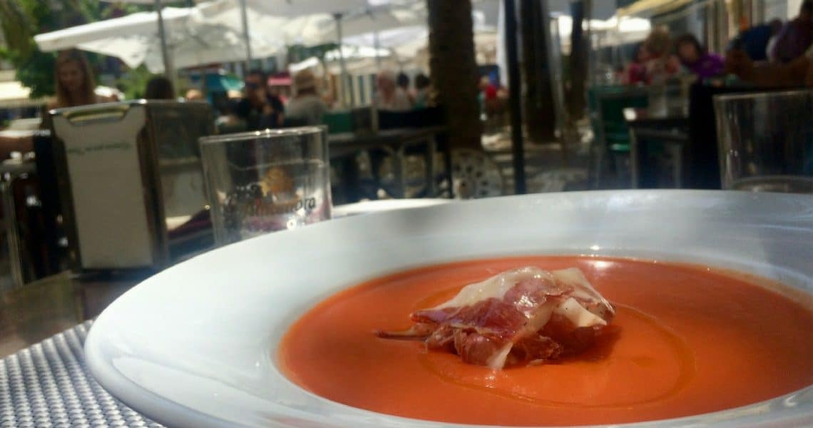 Salmorejo resemble gazpacho but is garnished with jamon, crumbled and olive oil. (Photo Credit: Casie Tennin)