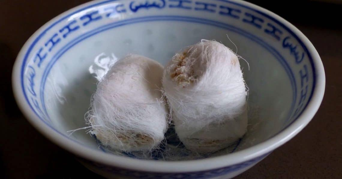 White dragon beard candy in a blue and white Chinese bowl